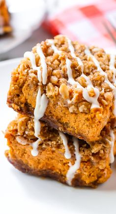 Pumpkin Streusel Bars complete with a gingersnap crust, brown sugar crumb topping, and sweet vanilla glaze. I love everything about them!