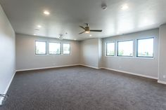 Oversized bonus room with natural light pouring in.