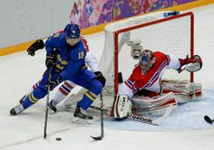 Sweden forward Nicklas Backstrom tries to wrap the puck around the goal against Czech Republic goaltender Jakub Kovar in the first period of a men's ice hockey game at the 2014 Winter Olympics, Wednesday, Feb. 12, 2014, in Sochi, Russia.