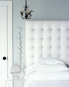 White Padded Headboard Sheets Lamps And Accents On Walls Calming
