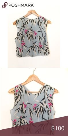 Elizabeth & James Cameo Cropped Top Elizabeth and James Cameo Cropped Floral Top Size S. Sleeveless. %100 Silk. Double button back and jewel neckline. So cute on. Very summery! Elizabeth and James Tops Blouses
