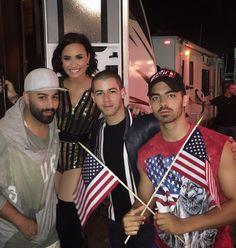 Demi Lovato Squeezes Herself Into Nick Jonas And Joe Jonas' Of July… Demi And Joe, Demi Lovato Style, Boston Pops, Wilmer Valderrama, Jonas Brothers, Hipster Outfits, Nick Jonas, Delena, Her Music