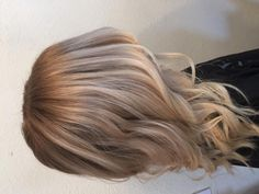 Apply root application in vertical sections through the sides blur by pulling color down as desired and same through the back of the head. Balayage the ends with lightener to revamp the blonde creating a brighter look. Base color: Loreal Majirel cool cover 8.1 + 10vol Ends: Paul Mitchell synchro lift + 20vol