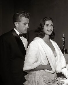 J.Dean & Pier Angeli, attend the premiere of the re-release of Gone With The Wind on August 10 1954 in Los Angeles, California.The Oscars won for the movie are in the background