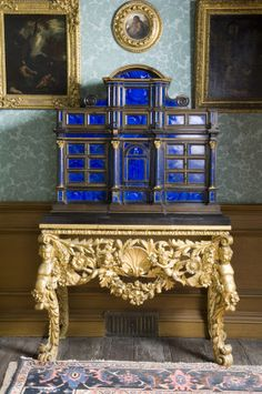 A fine and rare late 17th century lapis lazuli table cabinet of architectural form, the arched pediment centre flanked by volutes above a projecting entablature supported on four free standing Corinthian columns the front entirely panelled with richly coloured lapis lazuli within ebonised and parcel gilt moulded and beaded borders. Fitted with many ordinary and secret drawers. The top, sides and base of ebony.1670-1700