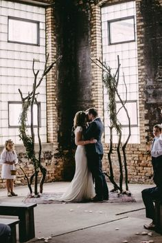 Cool alternative to traditional ceremony arch / http://www.deerpearlflowers.com/twigs-and-branches-wedding-ideas/2/