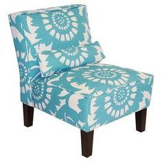 "Armless chair with floral upholstery and foam cushioning. Handmade in the USA.Product:  ChairConstruction Material:  Polyfoam padding, upholstered fabric, wood and metal  Color:  TurquoiseFeatures:  Pillow includedEye-catching daisy pattern Handmade in the USA Dimensions:  33"" H x 32"" W x 25"" D Note:  Assembly required Cleaning and Care:  Spot clean only"