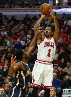 c116903cd84e Chicago Bulls guard Derrick Rose shoots over Indiana Pacers forward Solomon  Hill during the second half of an NBA basketball game in Chicago