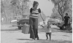 A Turkish woman and a child flee the fighting between Greeks and Turks in Cyprus in August 1974.   Photograph: Reg Lancaster/Getty Images