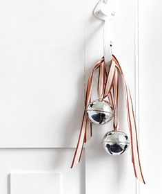 Tie big silver bells to the front doorknob with festive ribbon. Via realsimple.com