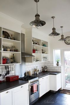Love this kitchen, especially the old-school industrial lights.