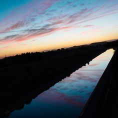 "Day 827 [9-24-15] ""Wedged Sunset"" - The Thermalito Power Canal catches a sunset.  A portion of the Feather River is temporarily diverted to the forebay and afterbay before returning to the river eight miles downstream.  Oroville, CA (weekly series: ""Feather River"" 