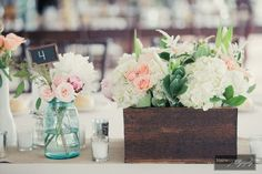 Wooden planter boxes, mason jars and coordinating bud vases with textural arrangement of peonies, hydrangea, spray roses, hypericum berries, parrot tulips, astilbe, seeded eucalyptus, varigated greens, dusty miller and succulents, by Flourish Event Design (Royal Oak, Michigan)
