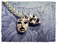 Tiny Comedy / Tragedy Theatre Masks Charm Necklace in Antique Pewter with a Delicate 18 Inch Silver Plated Cable Chain  http://www.etsy.com/listing/74777874/tiny-comedy-tragedy-theatre-masks-charm