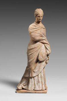 Terracotta statuette of a draped woman. Period: Hellenistic. Date: 3rd century B.C. Culture: Greek, Attic.   © 2000–2015 The Metropolitan Museum of Art