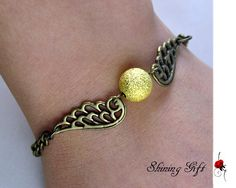 Special Offer---Golden Snitch Bracelet with wings. $2.99, via Etsy.