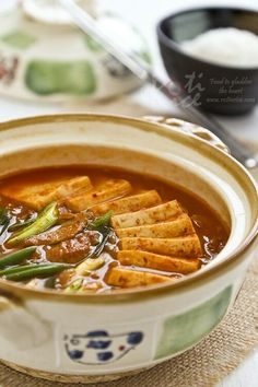 Kimchi Jjigae, a popular spicy Korean stew made with fermented Napa cabbage kimchi, pork (or beef), and tofu. Quick and easy to prepare. #koreanfood #kimchi #tofu