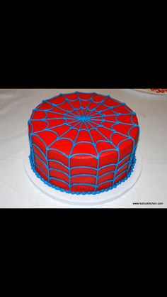 Blue and red spiderman spider web cake