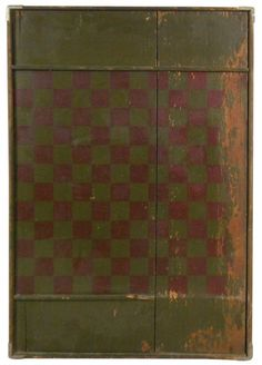 """Gameboard, early wooden checkerboard w/spaces on ends to hold game pieces, green & burgundy, reinforced cracks & corners, some paint wear, Good well-worn cond, 29.25""""H x 19.75""""W."""