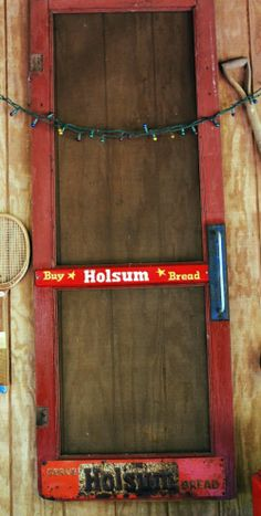 Dewena's Window. Old red screen door from grocery store with original Holsum Bread sign. In our picnic shelter.