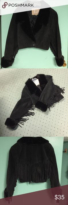 "VINTAGE BLACK SUEDE FAUX FUR CROP FRINGED JACKET This is a 70-80's Vintage black Suede crop jacket with Faux fur shawl collar and cuffs. One button closure at mid drift. Fringe is on both sleeves and across the back. Very dramatic jacket. Marked XS but fits more like a small -medium.  Please go by the measurements. Padding in shoulders. Bust measures  18""inches flat,shoulder to bottom of jacket measures 18""inches. Sleeve measures 22 inches. Fringe hangs from bottom of sleeve at 5 inches…"