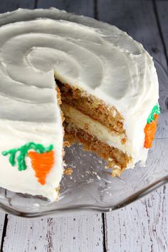 Carrot Cake Cheesecake Cake #Recipe- two layers of carrot cake with a layer of cheesecake sandwiched in-between. All covered with cream cheese frosting.