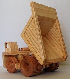 Wooden toy mine dump truck.