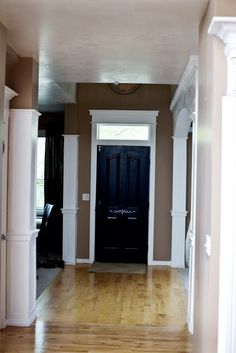 Garage access door. Black paint, mirror fake transom window. Even like the idea of 1/2 clock graphic on wall above.