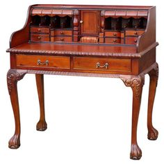 Full of character, this traditional hand-carved mahogany writing bureau is ideal for the budding writer and makes a great place to display framed photographs...