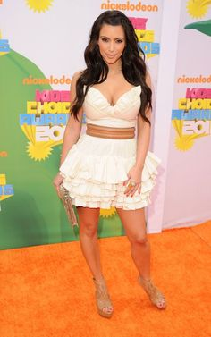 Kim Kardashian wearing Yves Saint Laurent Arty Ring Juliette Jake Fold Over Clutch Azzedine Alaia Leather Platform Sandals Adriana Castro Python Nina clutch Azzedine Alaia Ruffle Dress Unbranded White Ruffled Mini Dress. Kim Kardashian Nickelodeon Kids Choice Awards April 2 2011.