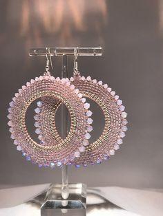 A personal favorite from my Etsy shop https://www.etsy.com/listing/507429249/rose-petal-pink-crystal-hoop-earrings