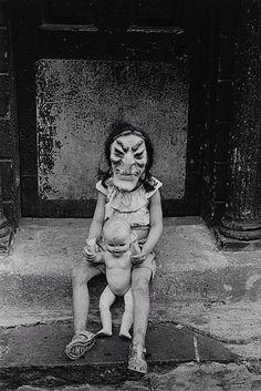 U.S. Masked Child with a Doll, N.Y.C., 1961 // by Diane Arbus