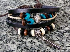 Friendship DIY Womens mens Leather bracelet with blue wood Bead and Metal leaf -gift bangle,wristband. $6.99, via Etsy.