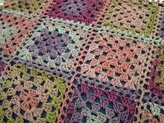 Colorful Fantasy Granny Afghan - Sweet pastel shades of variegated yarn make up this gorgeous crochet granny square afghan