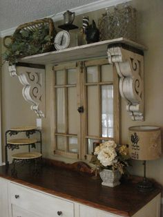 The Red Chandelier: Our First House (Dining Room). Wow, reclaimed window, corbels as shelf supports. this is lovely use of architectural salvage! ❤️ corbels flanking window over kitchen sink! Shabby Chic Decor, Rustic Decor, Farmhouse Decor, Farmhouse Style, Country Style, Salvaged Decor, Farmhouse Chandelier, Cottage Style, French Farmhouse