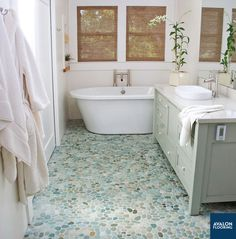 A beautiful large and flat pebble tile is a great addition to your bathroom retreat and helps you create the spa at home that you've always been looking for.