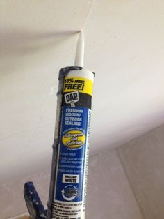 Use paintable caulk to patch small ceiling cracks, not drywall compound! If you use drywall compound the crack is likely to reappear  plus you have to sand it, ugh! Prepare a small bowl with soapy water (about a cup of water + a tsp of dish soap), put enough caulk on the crack to fill it, dip your finger or a scraper in the soapy water and smooth over the caulk, wait till it's dry and paint!