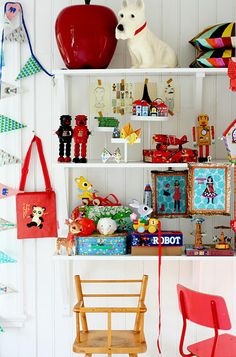 Eclectic / vintage inspired mix of treasures for a little boys room / baby boys nursery complete with doll's highchair, robots and scottie dog