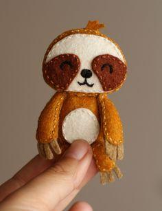 Felt Pocket Sloth doll brooch by PoCatFactory on Etsy https://www.etsy.com/listing/207355390/felt-pocket-sloth-doll-brooch