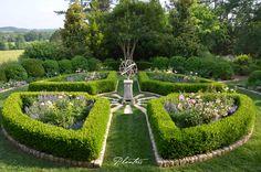 Parterre rose garden with armillary sphere. A Planters design. Rome, GA