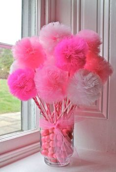 Tulle Pom Pom balls on sticks in a vase. Really cute party decor for any theme and color you'd have.