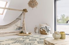 Indoor beach vibes felt by cozy hammock, bright lights, and rustic furniture Ibiza, Hanging Hammock Chair, Relaxation Room, Piece A Vivre, Vinyl Flooring, Elle Decor, Floor Rugs, Rustic Furniture, Outdoor Furniture