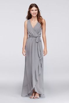 Sleek, simple, and ready to accessorize, this faux-wrap chiffon bridesmaid dress is a perfect pick for modern-minded 'maids who want to put their own stamp on their big-day look.   By Violets and Roses  Polyester  Button closure; lined to the knee  Dry clean  Imported