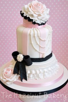 vintage couture wedding cake in pink, black and ivory, with pearls, ruffles and roses