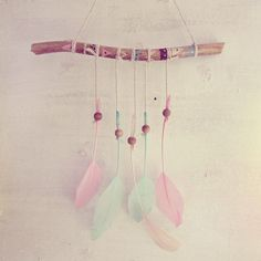Boho pastel driftwood wall hanging with axtec pattern  Made of  driftwood, feathers, wooden beads and linen cords.  Handpainted with acrylic paint, varnish and a bit of gli...