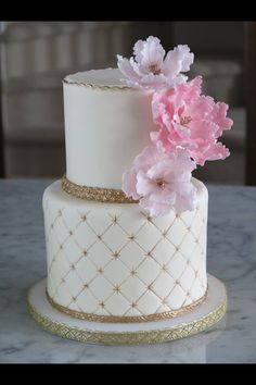 Pretty gold and Cream wedding cake with pink sugar flowers!