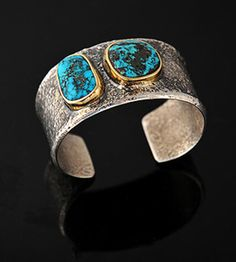 Cuff | Charles Loloma. Silver, with gold bezel holding a fine turquoise stones