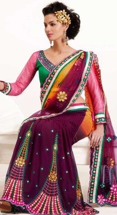 Let your personality articulate for you with this amazing embroidered saree.   This burgundy and dark yellow faux georgette and net lehenga style saree is nicely designed with embroidered patch work is done with resham, stone and lace work.   Beautiful embroidery work on saree make attractive to impress all.   This saree gives you a modern and different look in fabulous style.   Contrasting green blouse is available.