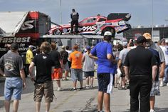 Courtney Force's Traxxus Funny Car gets unloaded from the trailer at the 2013 U.S. Nationals