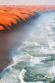 Where the Namib Desert meets the Atlantic Ocean  (by Roberto Moiola)